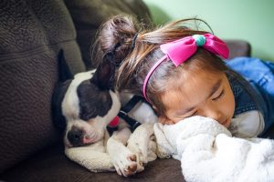 child sleeping with pup